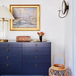 Blue and white dining room with mid century furniture