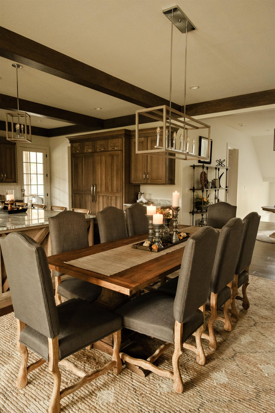 Weathered  dining chairs, rectangular pendant, dining table, rug, candles