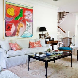Transitional living room for Louisiana family - a mix of antiques and modern art