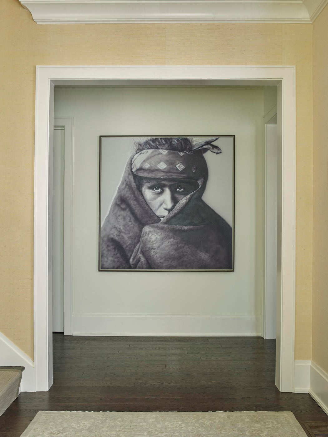 Entryway with dramatic art