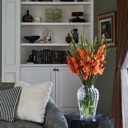 Living Room Vignette with Bookshelves and Ebonized Table