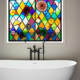 Sublime Stained Glass takes the spotlight in this master bath