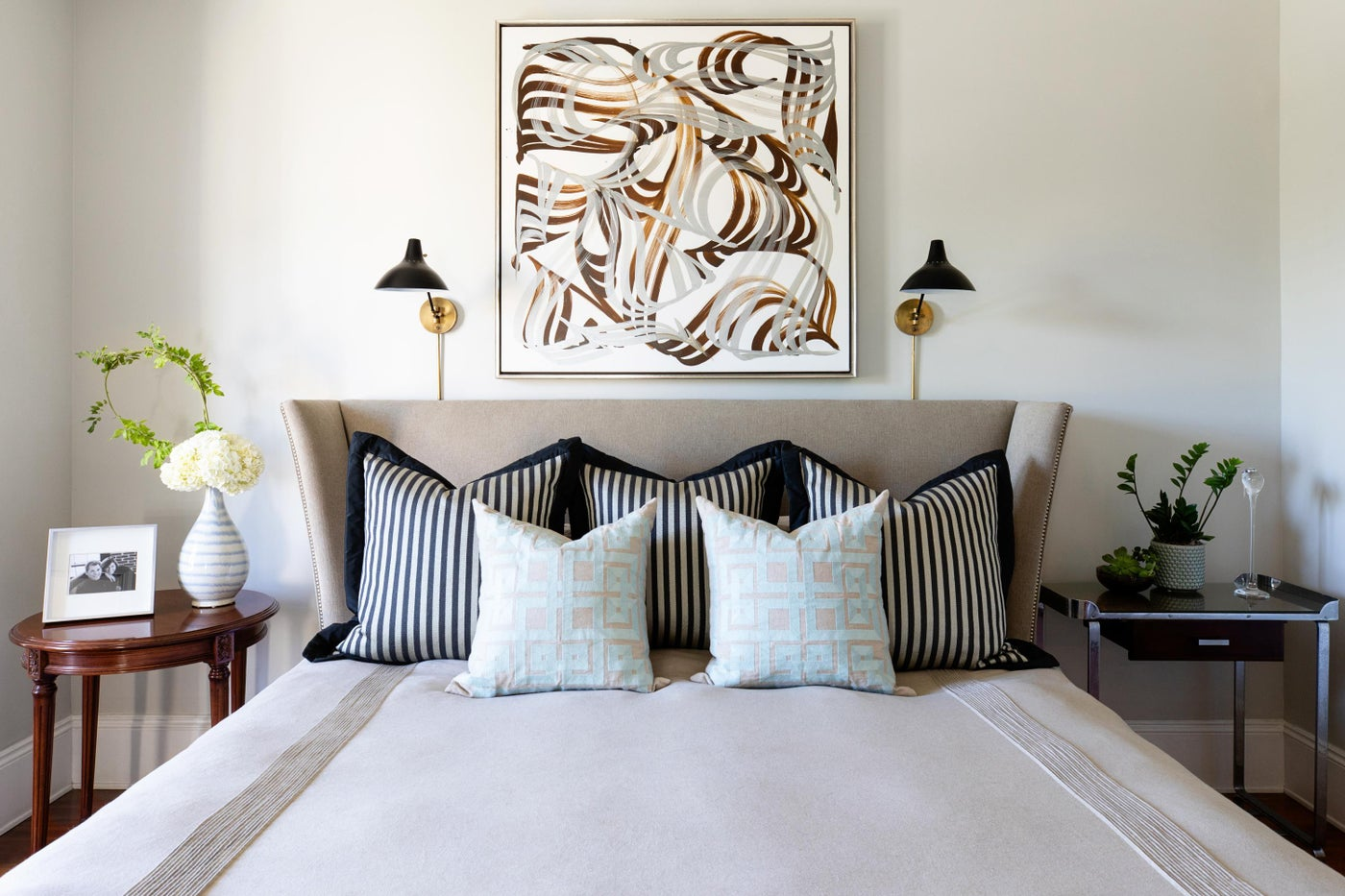 Eclectic Victorian master bedroom with abstract calligraphy painting by Yomar Agosto