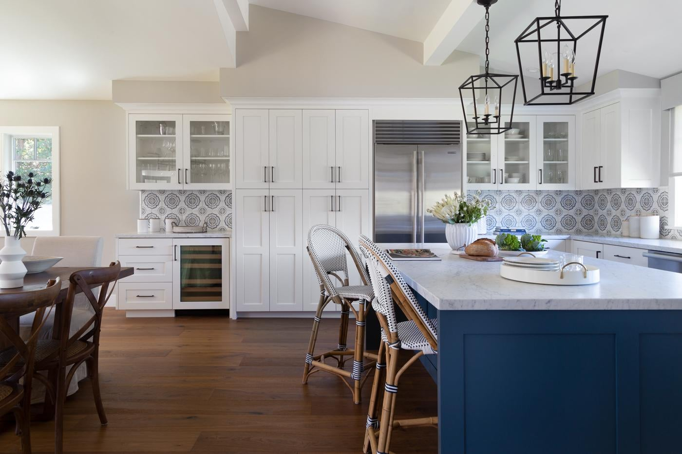 Classic White Kitchen with Blue Island and Lanterns