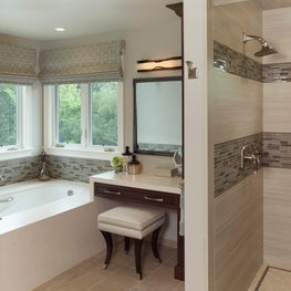 Master Bath with glass tile accents and waterfall edge detail at tub and vanity