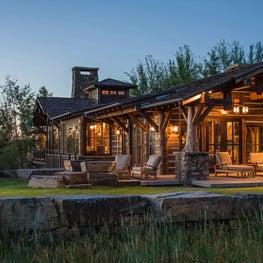 Elegant lodge with porch seating and hanging lanterns