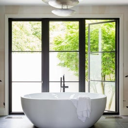 Open and Airy Master Bathroom with Freestanding Tub