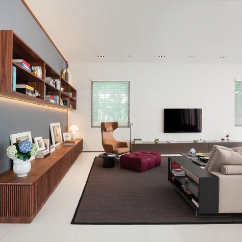 Family Room with Custom Built-in Library in Black Walnut