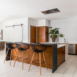 Transitional dining room & kitchen with counter seating in minimalist style
