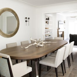 Clean sleek transitional contemporary dining room with white walls, wood table