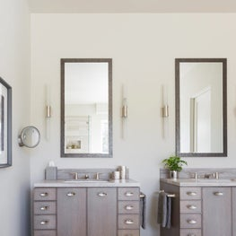 Custom designed side by side light grey stained rift sawn oak vanities anchor this Master Bathroom - Los Altos Hills Residence