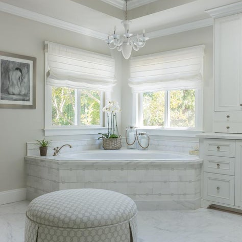 Master bathroom with mosaic tile, custom cabinetry and custom window treatments.