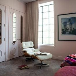 Kid's Bedroom with custom doors, pink walls, and Mid Century chair & ottoman,