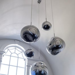 Mix of Modern and Traditional with Tom Dixon Pendants in Foyer