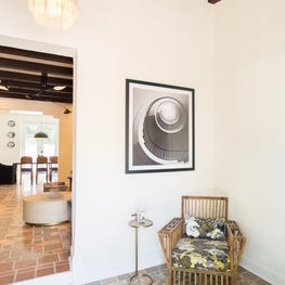 Florida Room entry foyer features original beams and mosaic floors