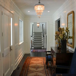 Traditional hallway and staircase, raised panels wainscoting and wall paneling