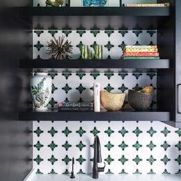 Mosaic Backsplash and custom shelving in renovation galley kitchen