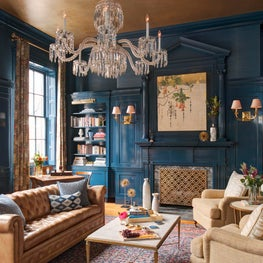 Bold and Glamourous Library in High Gloss Blue Paint and matching Grasscloth