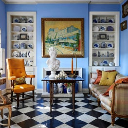 Grandmillenial vibes shine bright in this small, but layered living space full of antiques and collectibles.  As seen in Luxe Magazine.