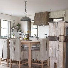 Montana farmhouse kitchen with custom white oak table and antique stone floor
