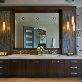 Master Bathroom featuring floating vanity lit from below and resin panel doors