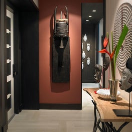 Earthly Aerie Foyer with Natural Hues and Bold Tribal Artwork