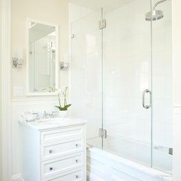 Clean, white bathroom with herringbone tile floor