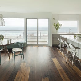 Midcentury modern dining & open kitchen, custom curved banquette with ocean view