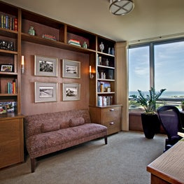 Lakefront Study with built ins, upholstered walls and period photos of Navy Pier