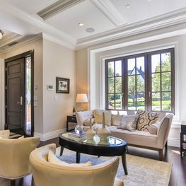 Sophisticated, comfortable living room with coffered ceiling