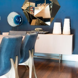 Modern and Luxurious Dining Room with Navy Ombre Wallpaper and Faceted Mirror and Custom Credenza