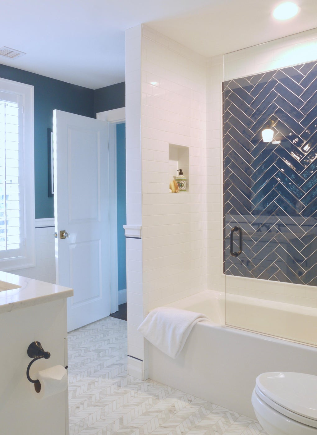 Blue and White Herringbone Boys Bath with Porcelain Chevron Floors
