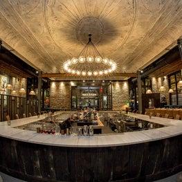 Ledger main bar & feature light on original ornate plaster ceiling in Salem, MA