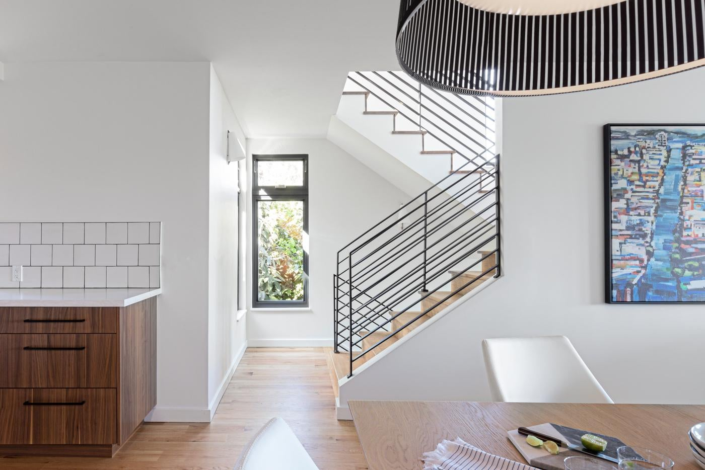 Contemporary Home with Metal Railing Staircase