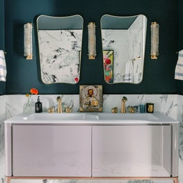 Master Bathroom with lacquer vanity, mid century mirrors and brass fixtures