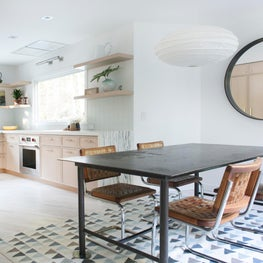 East Hampton Kitchen & Dining Table with Vintage Dining Chairs and Custom Cerused Oak Cabinetry with Farmhouse Sink