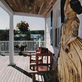 Maine Home front Porch Welcomes Guests with an Antique Statue from Bow of Boat