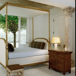 Canopy daybed with brick floors, column