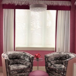 Pink sitting room, arm chairs, feather trim, pink walls, glam pendant, otto