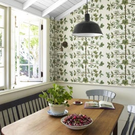 Bright breakfast nook with floral wallpaper