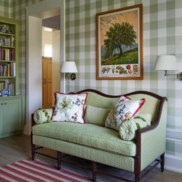 Settee in chic English Country style farmhouse, green gingham wallpaper