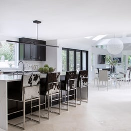 Gold Coast kitchen family room open floorplan, cowhide seating, marble island