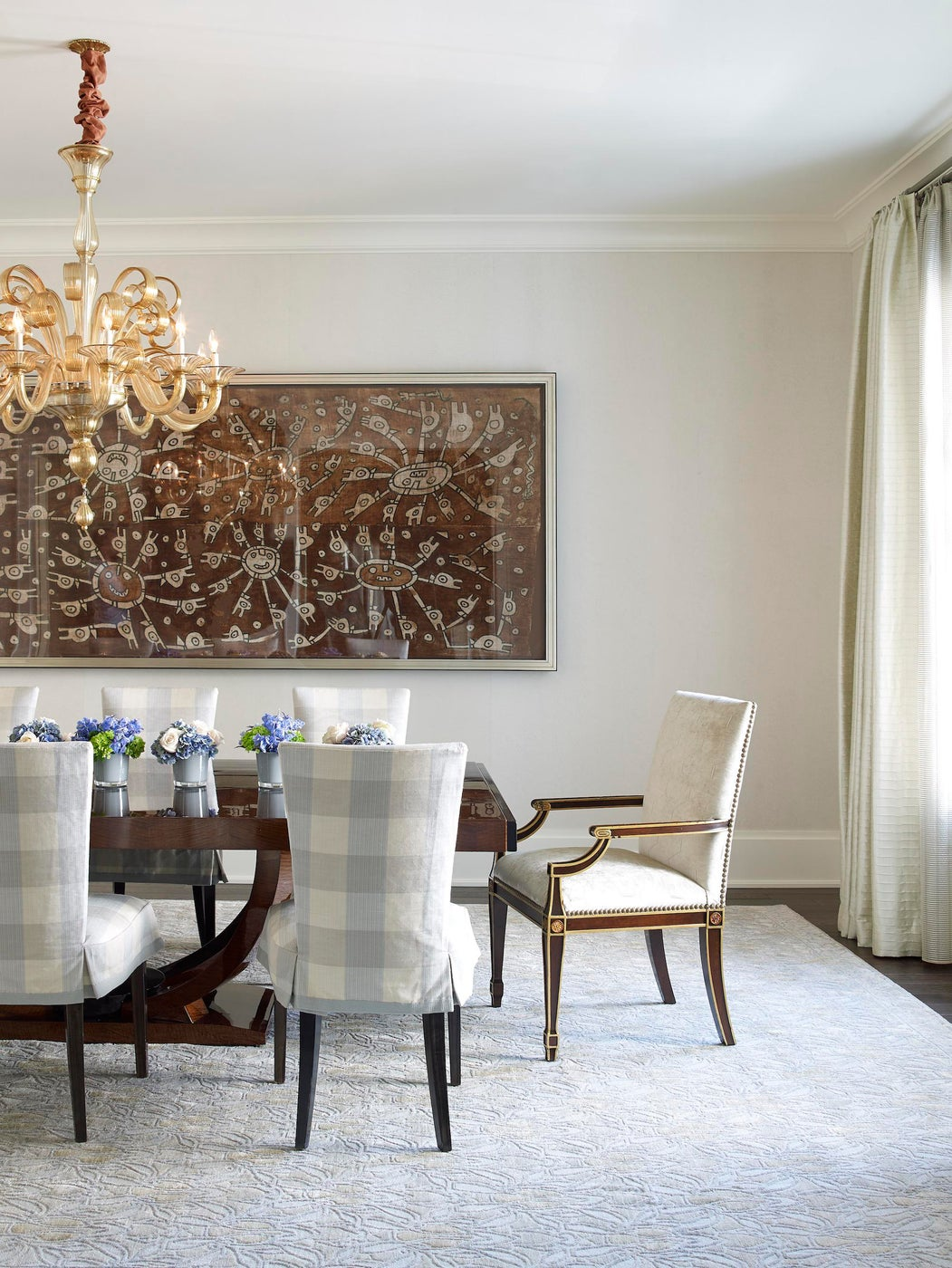 Dining room with ancient Peruvian textile in a Greenwich, CT