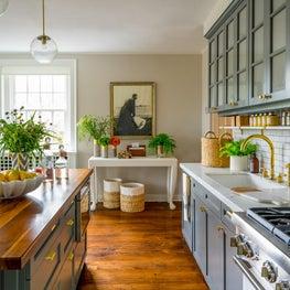 Bright Kitchen with Hardwood Floors, Dark Grey Cabinetry and Indoor Plants