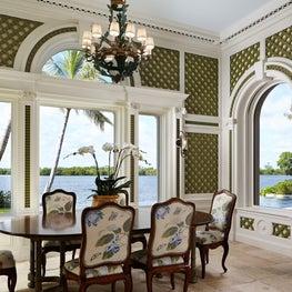 Treillage and antique limestone in a garden-reminiscent breakfast room