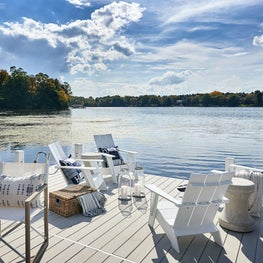 Dock, Outdoor Living, Hermes Pillows, Design Within Reach Adirondack Chairs, Made Goods Table, Raoul Textiles Pillow — Pine Lake Project