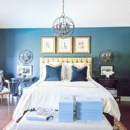 Gentleman's Miami master features dark blue walls and vintage British antiques