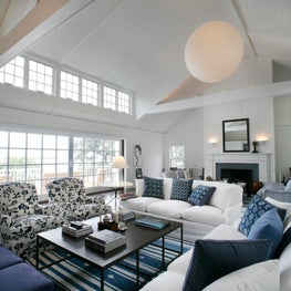 A renovated Living room with new painted planking and clerestory windows