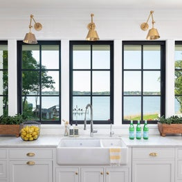 The glazed tile walls in the kitchen frame windows which look to the lake beyond