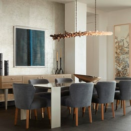 Malibu Dining Room with silver leaf wall and custom console